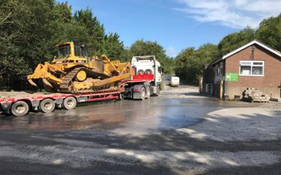 Low loader moving a D6-Dozer. Gower Plant Hire.